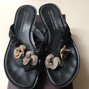 Shoes - Donald Pliner flip-flops with Rosette detailing.